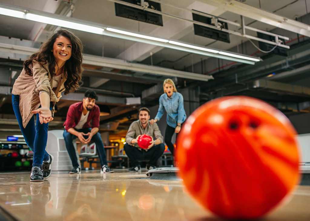 two couples bowling